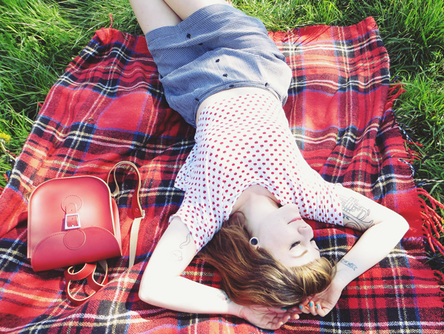 A red polka dot shirt and grey skirt + style tips from your favorite British fashion blogger!